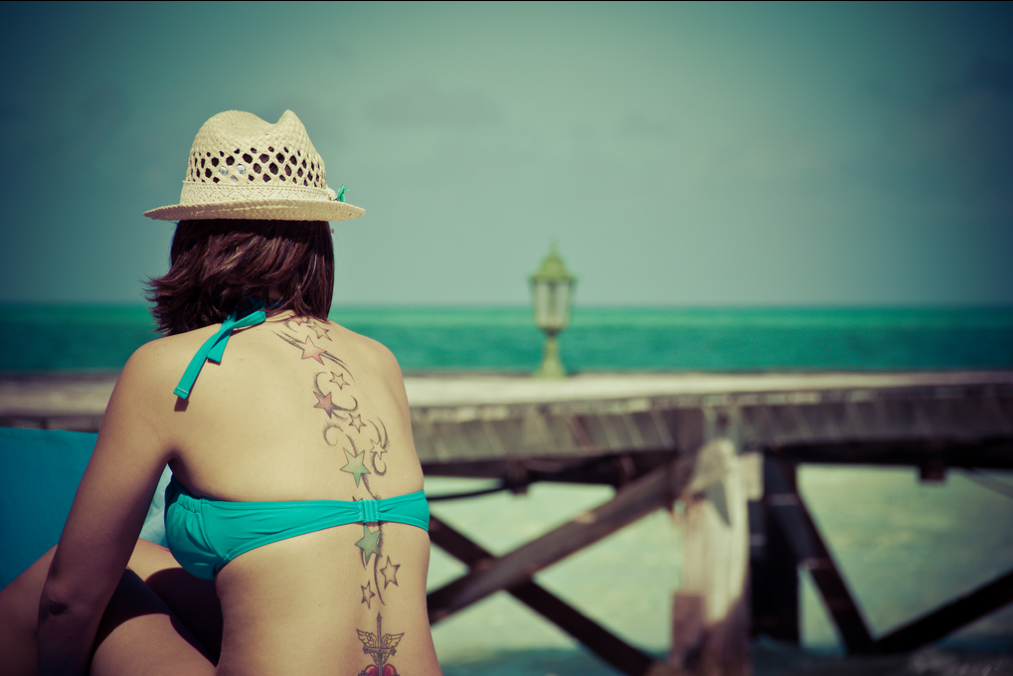 beach-girl-tattoo-stars-spine-tattoo
